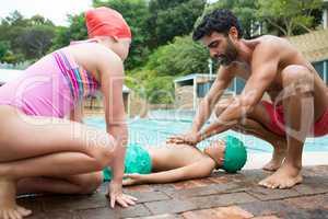 Lifeguard assisting unconscious boy