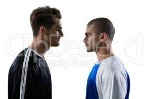 Two rival football player looking at each other