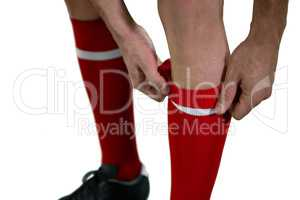 Football player pulling his socks up
