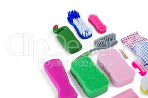 High angle view of various sponges and brushes with cleaning products