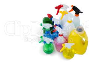 High angle view cleaning liquid in colorful spray bottles