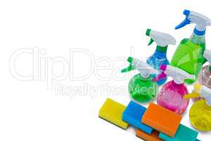 High angle view of spray bottles and cleaning sponge