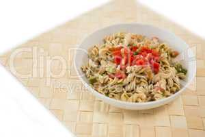 High angle view of rotini served in bowl on place mat