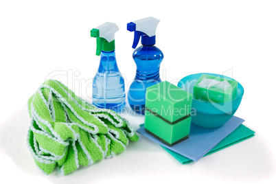 Close up of spray bottles with bowl and sponges