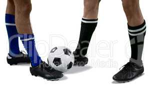 Two football players playing football