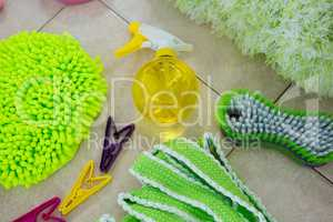 Overhead view of sponges and cleaning products on floor