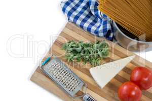 Food and grater on cutting board