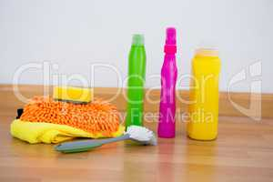 Chemical bottles by brush and sponges on floor