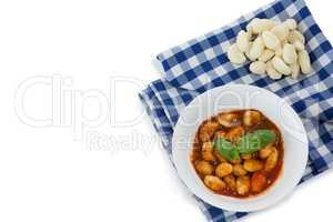 Overhead view of gnocchi pasta in bowl on napkin