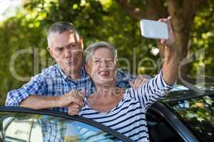 Playful senior couple taking selfie