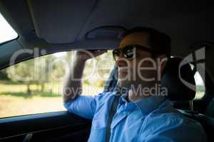 Man wearing sunglasses in car