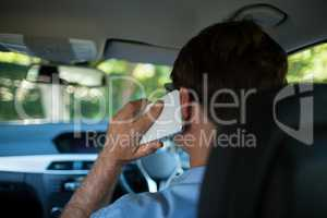 Man talking on phone while driving car