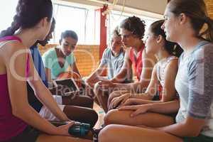 High school kids looking at digital tablet