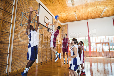 Player scoring a goal while playing basketball