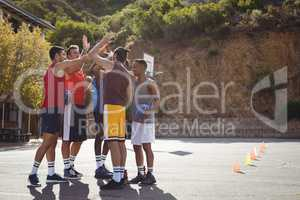 Basketball players giving high five to each other