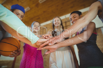 High school kids with their hands stacked