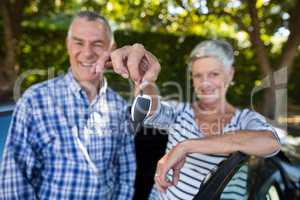 Senior couple showing car keys