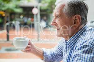 Senior man holding a coffee cup