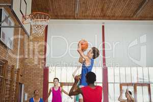 Determined high school kids playing basketball
