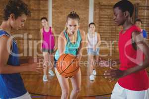 High school kids about to start playing basketball