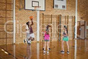 High school team playing basketball