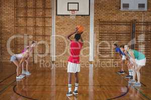 High school boy about to take a penalty shot while playing basketball