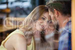 Close up of romantic couple sitting in cafe