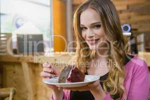 Portrait of beautiful woman having pastry