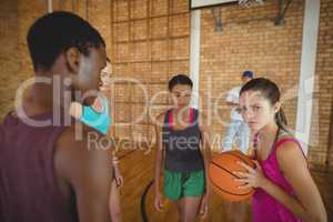 Concentrated high school kids playing basketball