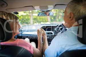 Loving senior couple sitting in car