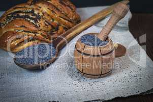 Poppy seeds in a wooden mortar
