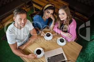 Friends sitting at cafe shop