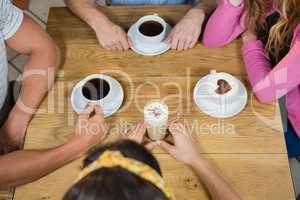 Friends having coffee at table