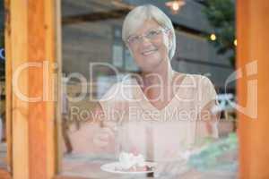 Thoughtful senior woman having breakfast