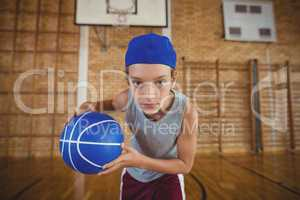 High school boy playing basketball in the court