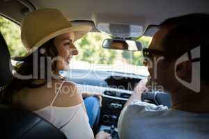 Young couple driving car