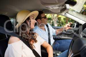 Happy couple taking selfie in car
