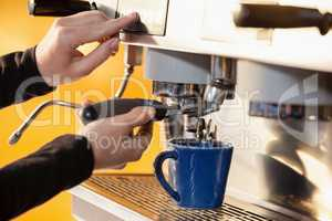 Cropped image of woman making coffee
