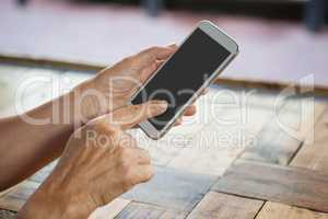 Cropped image of senior woman holding smart phone