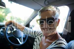 Portrait of senior woman driving car
