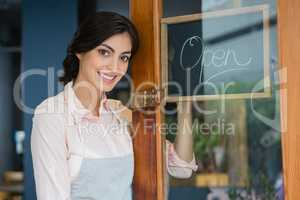 Portrait of waitress standing at the entrance