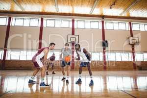 Basketball players ready for the jump ball