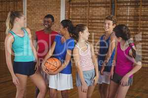 High school kids having fun in basketball court