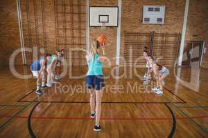 High school girl about to take a penalty shot while playing basketball