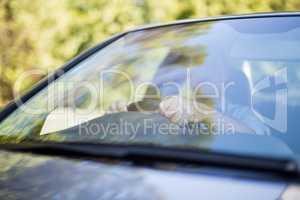 Man seen through windshield