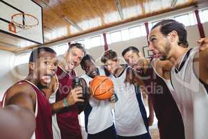 Happy basketball players making funny faces