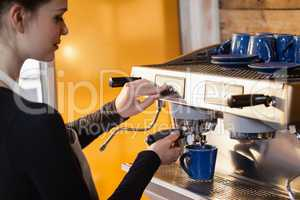 Owner making coffee at cafe shop