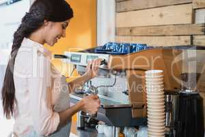Waitress using coffeemaker