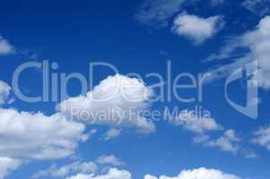 Cumulus white clouds against blue sky