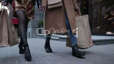 Sexy female legs walking on shopping street